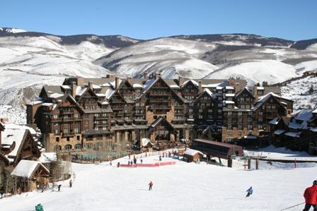 The Ritz-Carlton resort in Avon, CO set against a beautiful snowy mountain scene.
