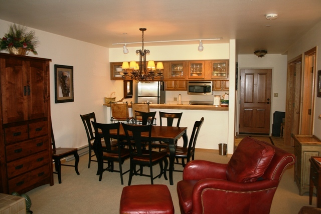 Dining room, kitchen and front door.
